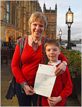 Sussex Green Living founder Carrie and her son awarded WWF Earth Hour Hero environmental awards at Houses of Parliament